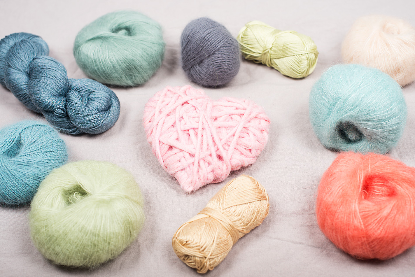 4 benefits of knitting: read more at LoveKnitting (image of luxury yarns surrounding a heart)